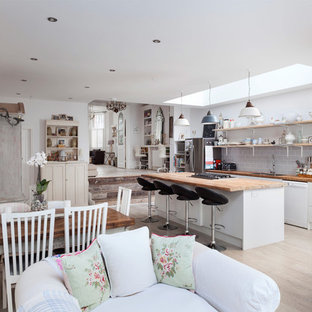 Photo of a shabby-chic style kitchen in London.