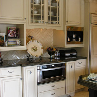 Example of a classic kitchen design in San Diego with raised-panel cabinets and beige cabinets