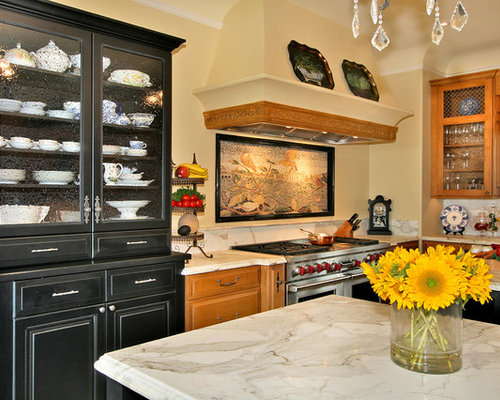 elegant kitchen photo in san diego with glassfront cabinets marble countertops medium