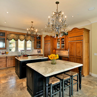 Inspiration for a timeless u-shaped kitchen remodel in San Diego with a farmhouse sink and marble countertops