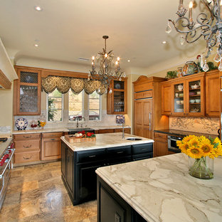 Traditional kitchen ideas - Elegant u-shaped kitchen photo in San Diego with a farmhouse sink and marble countertops