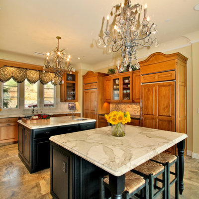 Elegant kitchen photo in San Diego with marble countertops and two islands