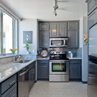 Inspiration for a small transitional l-shaped separate kitchen in San Francisco with an undermount sink, grey cabinets, grey splashback, ceramic splashback, stainless steel appliances, no island, raised-panel cabinets, granite benchtops, vinyl floors and beige floor.