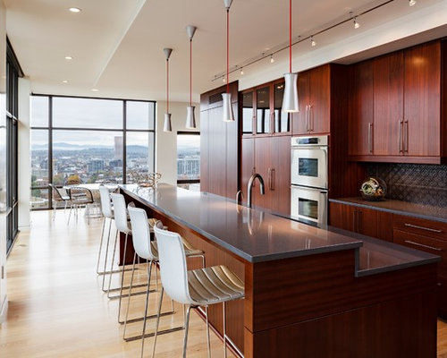 Modern L Shaped Eat In Kitchen Idea In Portland With Flat Panel Cabinets