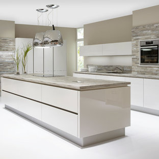 Photo of a large modern l-shaped kitchen/diner in Other.