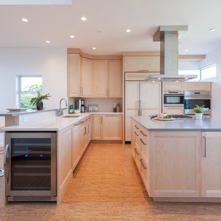 Photo of a contemporary u-shaped open plan kitchen in Vancouver with an undermount sink, shaker cabinets, light wood cabinets, quartz benchtops, white splashback, stone tile splashback, panelled appliances, cork floors and with island.