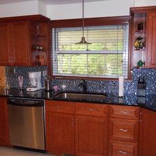 Modern Kitchen by Asheville Kitchens and Baths Inc.