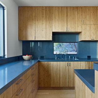 Modern kitchen remodeling - Minimalist kitchen photo in San Francisco with flat-panel cabinets, medium tone wood cabinets, blue backsplash and blue countertops