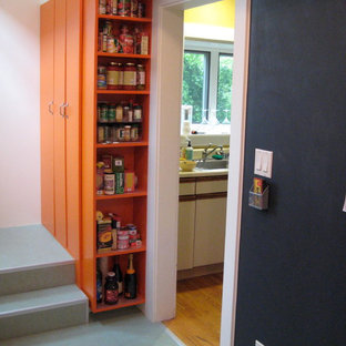 Design ideas for a mid-sized contemporary kitchen pantry in San Francisco with open cabinets, orange cabinets and grey floor.