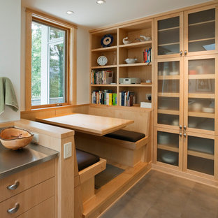 Contemporary galley kitchen/diner in Seattle with flat-panel cabinets, light wood cabinets, stainless steel worktops, porcelain flooring and no island.