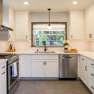Mid-sized transitional enclosed kitchen remodeling - Enclosed kitchen - mid-sized transitional u-shaped porcelain floor enclosed kitchen idea in Miami with an undermount sink, shaker cabinets, white cabinets, quartz countertops, white backsplash, marble backsplash, stainless steel appliances and no island