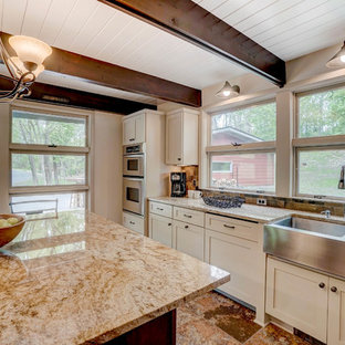 Photo of a mid-sized midcentury l-shaped separate kitchen in Minneapolis with a farmhouse sink, recessed-panel cabinets, beige cabinets, granite benchtops, multi-coloured splashback, ceramic splashback, stainless steel appliances, ceramic floors, with island, multi-coloured floor and beige benchtop.