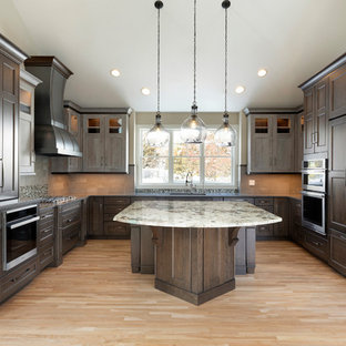 Mid-sized transitional kitchen designs - Example of a mid-sized transitional u-shaped light wood floor and beige floor kitchen design in Minneapolis with recessed-panel cabinets, dark wood cabinets, quartz countertops, gray backsplash, ceramic backsplash, stainless steel appliances, an island, a single-bowl sink and gray countertops