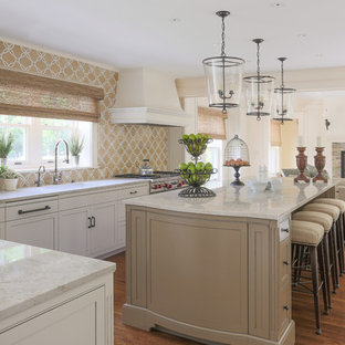 Photo of a traditional l-shaped open plan kitchen in Boston with a single-bowl sink, beaded inset cabinets, white cabinets, multi-coloured splashback, stainless steel appliances, medium hardwood floors and with island.