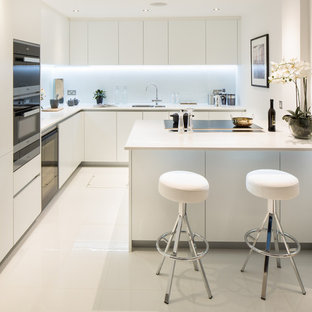 Trendy L Shaped Kitchen Photo In London With An Undermount Sink, Flat Panel