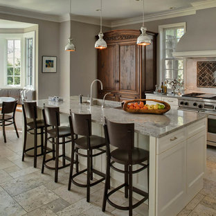 Traditional eat-in kitchen photos - Eat-in kitchen - traditional eat-in kitchen idea in Chicago with shaker cabinets, white cabinets, brown backsplash and stainless steel appliances