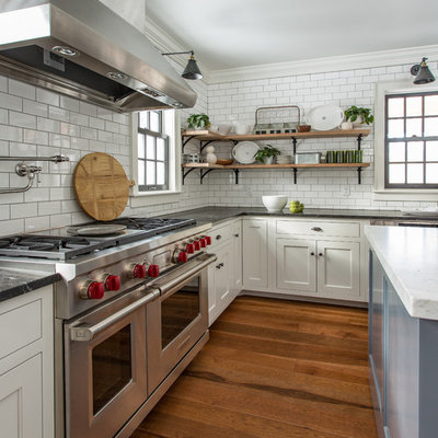 Inspiration for a farmhouse medium tone wood floor kitchen remodel in Boston with recessed-panel cabinets, white cabinets, subway tile backsplash, stainless steel appliances and an island