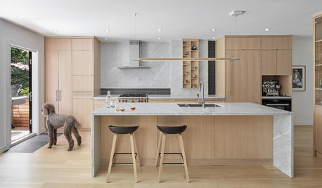 18 Kitchens Where Gorgeous Waterfall Worktops Take Centre Stage