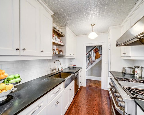 elegant galley enclosed kitchen photo in toronto with a farmhouse sink cabinets