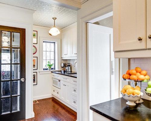 Elegant kitchen photo in Toronto with subway tile backsplash & Tin Door Inserts | Houzz