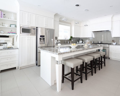 Mid sized zimbabwe gray granite kitchen design ideas for Kitchen cabinets zimbabwe