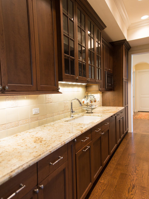 Traditional Kitchen Pantry With Cement Tile Backsplash