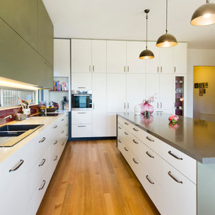 Large transitional open concept kitchen designs - Large transitional l-shaped light wood floor and brown floor open concept kitchen photo in Melbourne with a double-bowl sink, flat-panel cabinets, white cabinets, red backsplash, an island, quartz countertops, glass sheet backsplash, stainless steel appliances and brown countertops