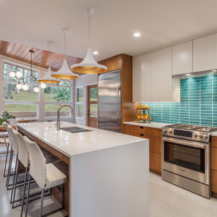 Photo of a mid-sized midcentury eat-in kitchen in Other with blue splashback, stainless steel appliances, with island, a double-bowl sink, flat-panel cabinets, white cabinets, quartzite benchtops, ceramic splashback and grey floor.