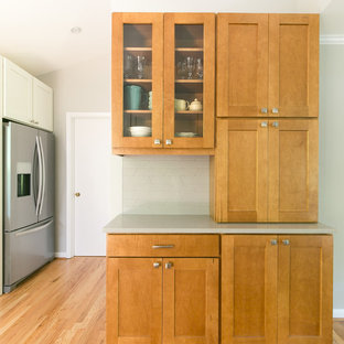 Design ideas for a mid-sized midcentury u-shaped eat-in kitchen in Atlanta with shaker cabinets, white cabinets, quartz benchtops, grey splashback, ceramic splashback, stainless steel appliances, light hardwood floors, a peninsula, brown floor, grey benchtop and a double-bowl sink.