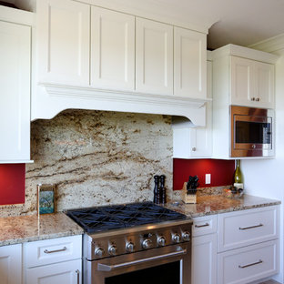 Large craftsman eat-in kitchen designs - Example of a large arts and crafts u-shaped ceramic floor eat-in kitchen design in Other with an undermount sink, recessed-panel cabinets, white cabinets, granite countertops, red backsplash, wood backsplash, stainless steel appliances and an island