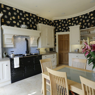This is an example of a traditional eat-in kitchen in Glasgow with blue splashback, black appliances, white cabinets and recessed-panel cabinets.