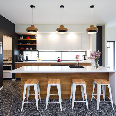 Open concept kitchen - mid-sized contemporary galley concrete floor and gray floor open concept kitchen idea in Brisbane with an undermount sink, medium tone wood cabinets, quartz countertops, multicolored backsplash, window backsplash, stainless steel appliances, an island and flat-panel cabinets