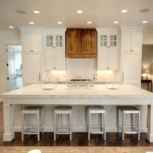 Traditional kitchen inspiration - Example of a classic kitchen design in Atlanta with granite countertops and white cabinets