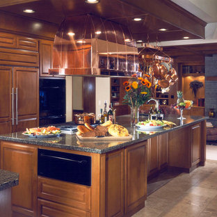 This is an example of a large traditional kitchen in Seattle with a drop-in sink, granite benchtops and ceramic floors.