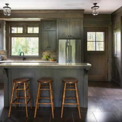Inspiration for a rustic l-shaped kitchen remodel in Minneapolis with an undermount sink, shaker cabinets, dark wood cabinets, stainless steel appliances, an island, multicolored backsplash and stone tile backsplash
