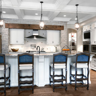 Traditional kitchen appliance - Example of a classic kitchen design in Chicago with beaded inset cabinets, white cabinets, granite countertops, white backsplash and stainless steel appliances