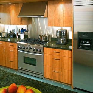 Kitchen appliance - Inspiration for a slate floor kitchen remodel in San Francisco with an undermount sink, flat-panel cabinets, medium tone wood cabinets, stainless steel appliances and an island