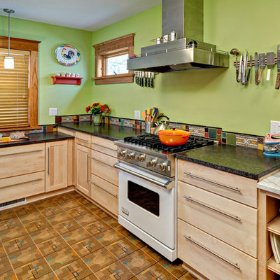 Inspiration for a small eclectic u-shaped linoleum floor eat-in kitchen remodel in Minneapolis with white appliances, an undermount sink, flat-panel cabinets, light wood cabinets, quartz countertops, multicolored backsplash, ceramic backsplash and no island