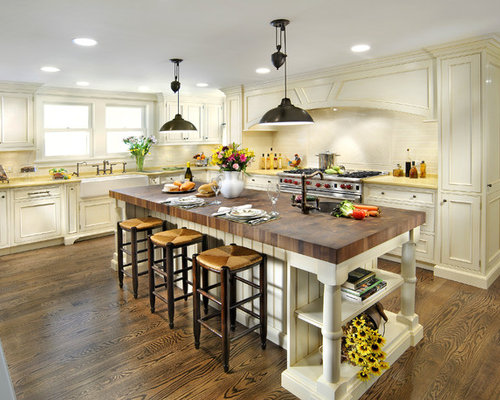 Traditional Kitchen Idea In Chicago With Stainless Steel Appliances A Farmhouse Sink And Wood Countertops