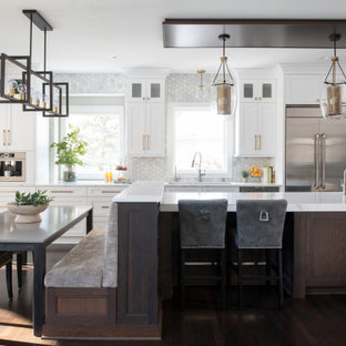 Photo of a large transitional l-shaped eat-in kitchen in Minneapolis with with island, recessed-panel cabinets, white cabinets, quartz benchtops, grey splashback, marble splashback, stainless steel appliances, white benchtop, a triple-bowl sink, medium hardwood floors, brown floor and wood.