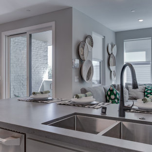 Open concept kitchen designs - Open concept kitchen - l-shaped beige floor open concept kitchen idea in San Francisco with an undermount sink, recessed-panel cabinets, white backsplash, stainless steel appliances and an island