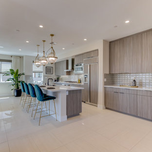 Open concept kitchen designs - Inspiration for a single-wall open concept kitchen remodel in San Francisco with an undermount sink, light wood cabinets, paneled appliances and an island