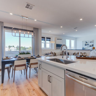 Open concept kitchen pictures - Inspiration for a l-shaped open concept kitchen remodel in San Francisco with an undermount sink, recessed-panel cabinets, gray cabinets, stainless steel appliances and an island