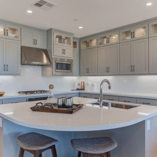 Open concept kitchen ideas - Open concept kitchen - l-shaped open concept kitchen idea in San Francisco with an undermount sink, recessed-panel cabinets, gray cabinets, stainless steel appliances and an island