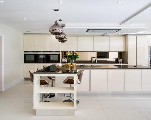 Cucina con top in vetro e pavimento in ardesia - Foto e Idee per ...