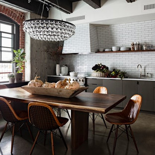 Industrial eat-in kitchen in Portland with open cabinets, black cabinets, white splashback and subway tile splashback.
