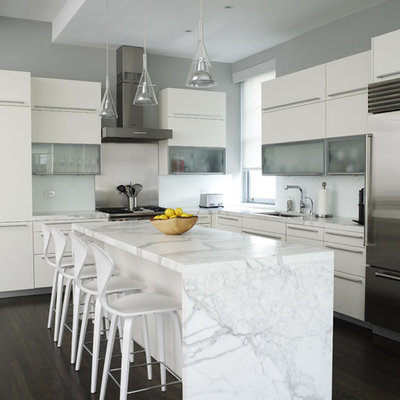 Inspiration for a contemporary l-shaped kitchen remodel in New York with stainless steel appliances, white cabinets, marble countertops and flat-panel cabinets
