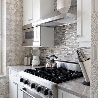 Photo of a small classic kitchen in New York with grey splashback.