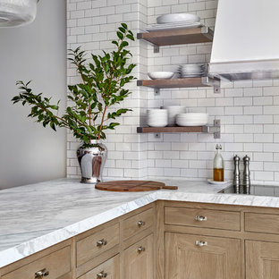 Design ideas for a transitional kitchen in Chicago with an undermount sink, recessed-panel cabinets, light wood cabinets, quartzite benchtops, white splashback, ceramic splashback, porcelain floors, a peninsula, multi-coloured floor and white benchtop.