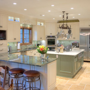 Inspiration for a mid-sized traditional u-shaped eat-in kitchen in Chicago with a double-bowl sink, raised-panel cabinets, white cabinets, marble benchtops, green splashback, porcelain splashback, stainless steel appliances, ceramic floors and multiple islands.